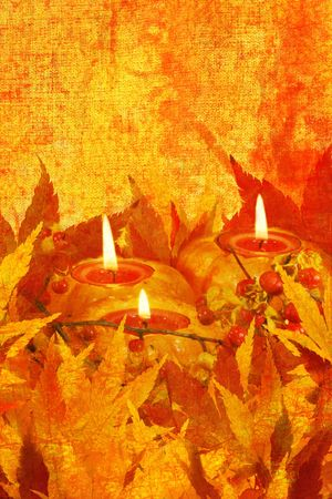 autumn grunge background: mini pumpkins with colored tea lights, fresh bittersweet berries & branches, Japanese maple leaves photo