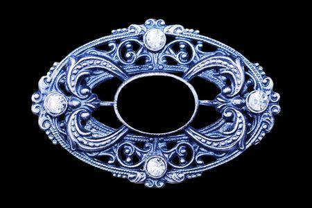 brooch: ornate vintage brooch as frame, label, design element