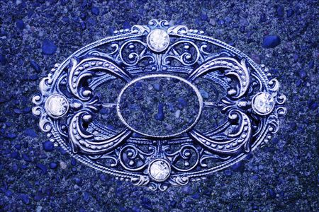 ornate vintage brooch as blue grunge background Stock Photo
