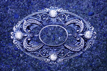 brooch: ornate vintage brooch as blue grunge background Stock Photo