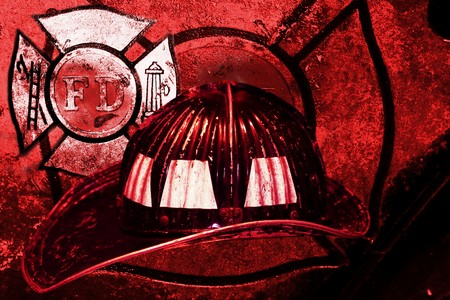 vintage firefighter helmet grunge background photo