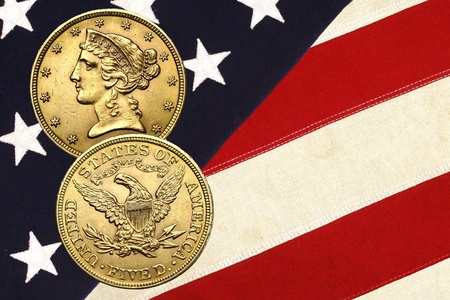 Liberty gold coin atop stars and stripes photo
