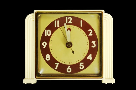 vintage ca. 1930s clock with hands nearing midnight photo