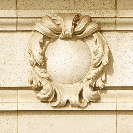 stonemasonry: Elegant stone shield detail on old building as frame, background