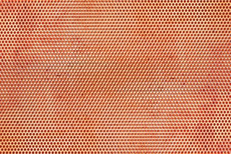 round hole perforated metal sheets as grunge abstract background  Imagens