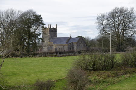St Laurence Parish Church, Priddy, Somerset 13th Century grade I listed Church viewed across fields Stock Photo