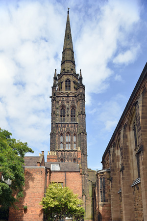 Tower & Spire of Coventry Old Cathedral viewed from behind St Marys Guildhall