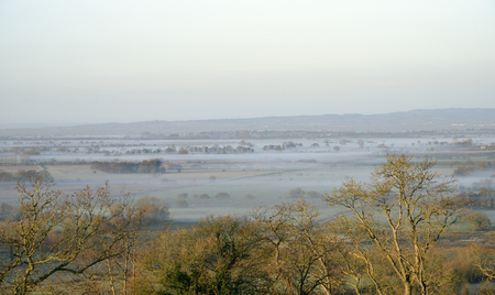 Mist in Butleigh Moor viewed from Polden Hills, Somerset Levels Stock Photo