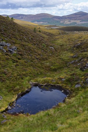 Small Lochan in Chalamain Gap, Cairngorm Mountains, highland Scotland