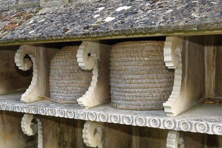 Cotswold Stone Bee Shelter in the church yard at Hartpury, Gloucestershire, UK
