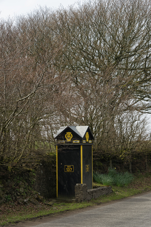 AA Box 137 at Pittcombe Head, above Porlock Hill, Exmoor, Somerset, UK  Grade II listed motoring assistance Telephone Box