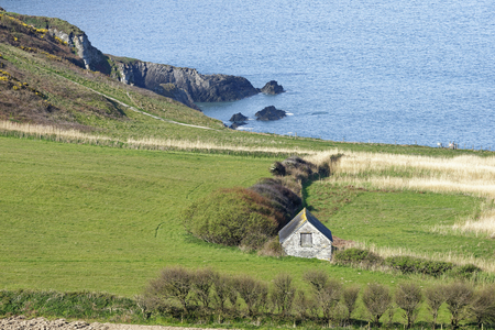 Field Barn at Rockham Bay, North Devon, UK  Viewed from above Bull Point Reklamní fotografie