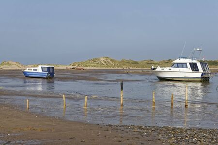 Boats beached as tide goes out, Crow Point, Braunton Burrows, North Devon, UK