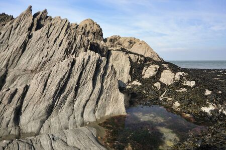Mort Slate rock formation with Rock Pool, Lee Bay