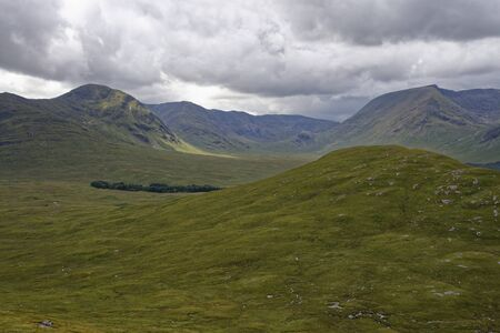 Coire Bà, Stob a Choire Odhair (left) & Clach Leathad (right), Meall Beag (foregraound) viewed from Meall Mor monument, Rannoch Moor, Highland, Scotland, UK