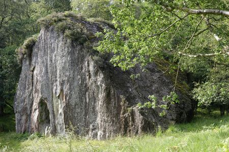 Pulpit Rock, or Clach nan Tarbh (the stone of the bulls), Loch Lomond, Argyll, Scotland, UK  A Vestry cut into the rock face to provide for outdoor services from 1825 until 1895