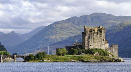 Eilean Donan Castle, Loch Duich, Dornie, Highland, Scotland, UK 13th Century Castle reconstructed early 20th century, Sgurr Mhic Bharraich behind