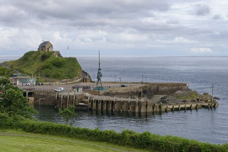 Ilfracombe Outer Harbour with Lantern Hill & Verity Statue, Devon, UK Viewed from viewed Larkstone Hill