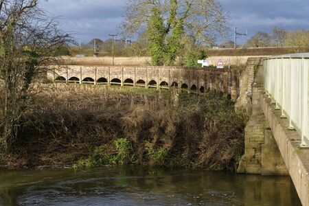 River Avon at Kellaway Bridge with Maud Heath's Causeway and Electric Railway behind, Kellaway, Chippenham, Wiltshire, UK