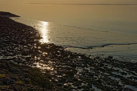Sunset at Walton Bay, Clevedon with Cardiff beyond Severn Estuary Reklamní fotografie