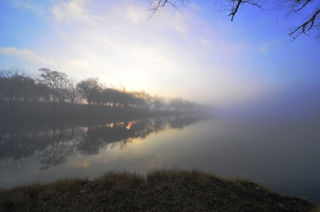 blue foggy morning sunrise on the river, texas hillcountry photo