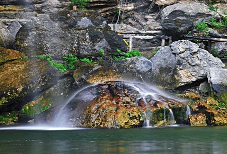 waterfall hitting large rock,hamilton pool,texas hillcountry Stock Photo - 9922509