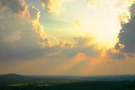 awe-inspiring thunderhead,sunset,golden sun rays