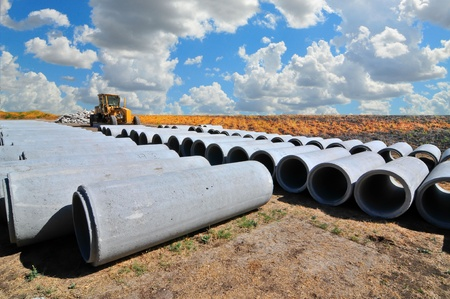 construction machinery: construction site,road grader,water pipe Stock Photo