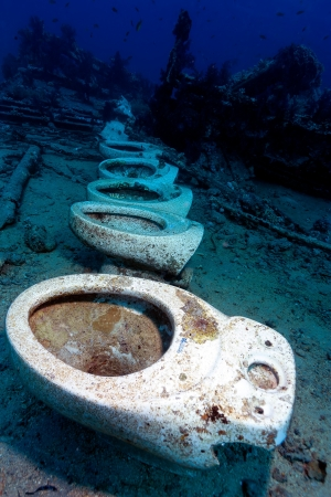 A line of ceramic toilets underwater on the site of the Yolanda shipwreck in the Red Sea