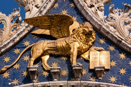 The golden winged lion of St Mark on the basilica in Venice