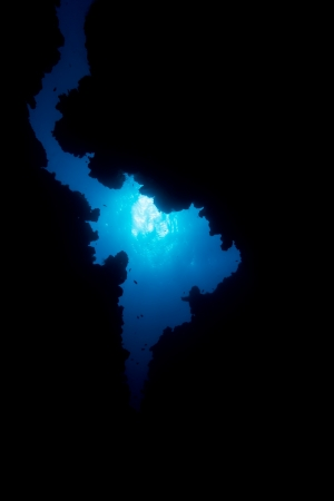 Blue water through the exit of an underwater cave Stock Photo - 16942108