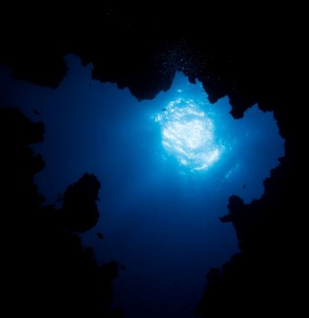 Sunburst through the exit of an underwater cave