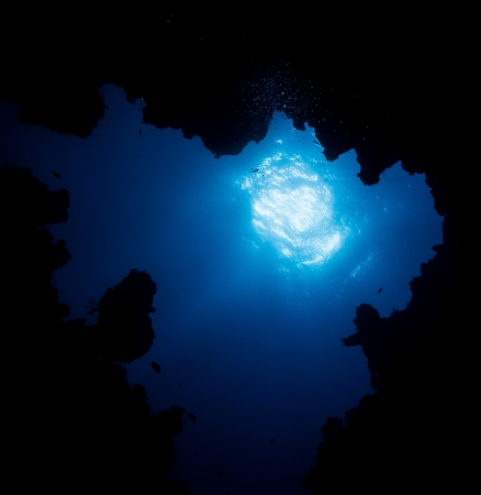 Sunburst through the exit of an underwater cave