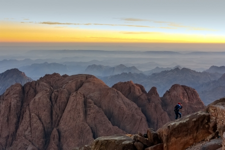 sinai: A person admires sunrise on the top of Mount Sinai Stock Photo