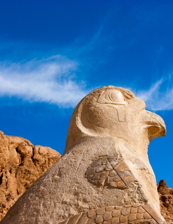 The statue of Nekhbet in vulture form guardian the entrance to the upper tier of Queen Hatshepsut Stock Photo