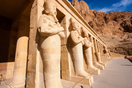Statues of the god Osiris at Hapshetpsut Stock Photo