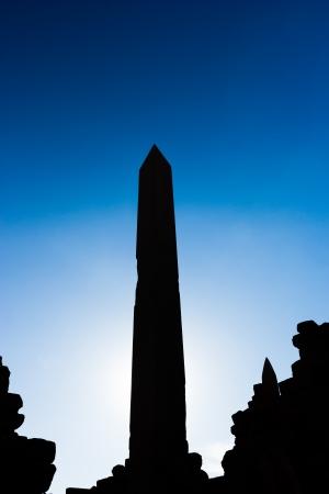 obelisk stone: An ancient tall Obelisk in silhouette against a blue sky in the Karnak Temple, Luxor, Egypt