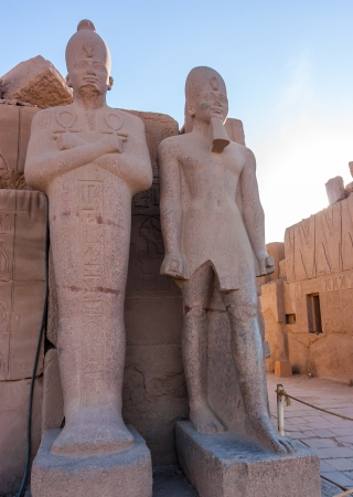 Ancient statues in the late afternoon at Karnak Temple, Luxor, Egypt photo