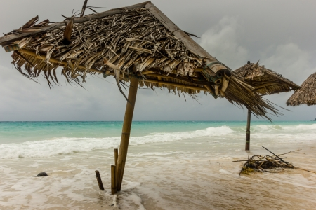 Monsoon winds and storms flood a tropical beach