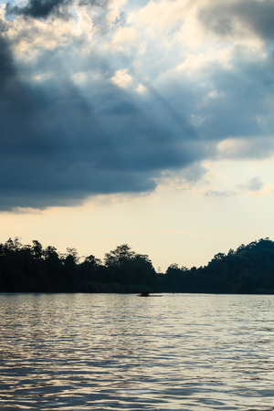 Sunbeams over a rainforest river Stock Photo