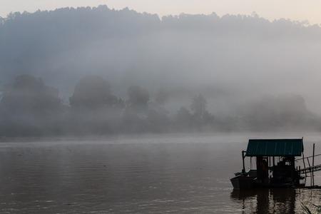 Just before sunrise on the Sungai Kinabatangan river in the rainforest of Borneo photo