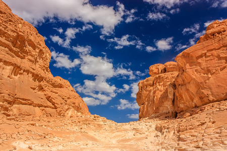 sinai: White clouds over a hot,empty, desert canyon Stock Photo