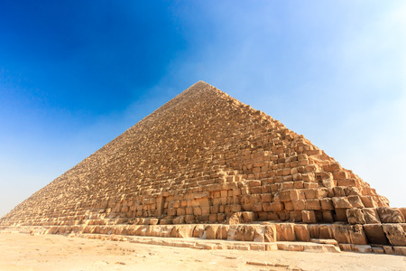 masr: The Great Pyramid in Giza surrounded by early morning smog in Cairo Stock Photo