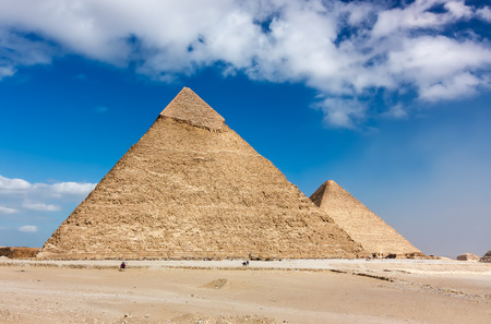 Two of the ancient Pyramids at Giza with the morning smog of Cairo in the air   Since the 2011 revolution, tourism has declined massively in Egypt