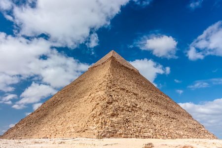 masr: The pyramid of Khafre with the original stone cladding on its apex and a camel in front