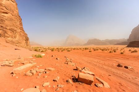 Rocks and orange sand in the Jordanian desert