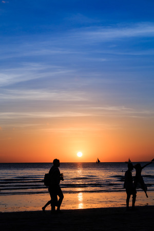 Tropical sunset silhouettes photo