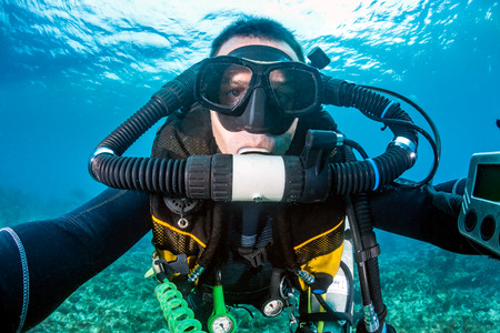 closed circuit: SCUBA diver with a closed circuit rebreather on a tropical coral reef Stock Photo