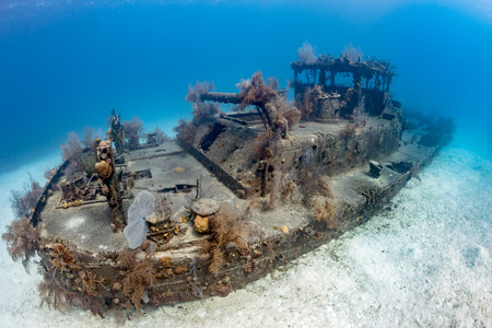 Old, coral encrusted shipwreck on the sea floor Stock Photo