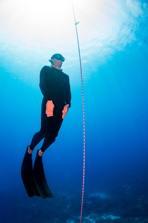 Freediver ascending a line Stock Photo